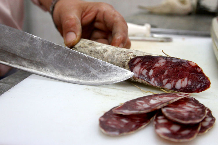 Salami Production, Colonia Caroya, Córdoba, Argentina Córdoba Food And Drink Production Salame Argentina Butcher Chopping Close-up Cutting Food Food And Drink Gastronomy Human Hand Indoors  Kitchen Knife Meat People Preparation  Production Line Salami