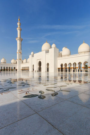 Sheikh Zayed mosque in Abu-Dhabi Abu Dhabi Arabic Arch Architectural Column Architecture Blue Building Exterior Built Structure Clear Sky Courtyard  Dome Faith Flooring History Islam Mosque People Religion Sheik Zayed Mosque Spirituality Tiled Floor Travel Destinations United Arab Emirates White Color White Mosque
