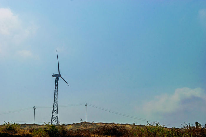 Alternative Energy Beauty In Nature Day Environmental Conservation Field Fuel And Power Generation Industrial Windmill Landscape Low Angle View Nature No People Outdoors Renewable Energy Rural Scene Sky Technology Wind Power Wind Turbine Windmill