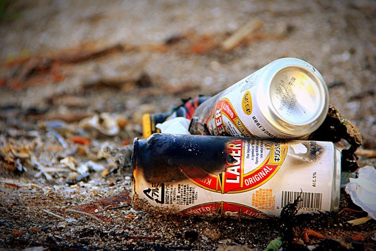 After Beer EyeEm Selects Land Sand Beach No People Nature Text Day Close-up High Angle View Focus On Foreground Outdoors Still Life Sunlight Communication Field Western Script Sport Drink Can Sea Arts Culture And Entertainment Adventures In The City Focus On The Story Going Remote