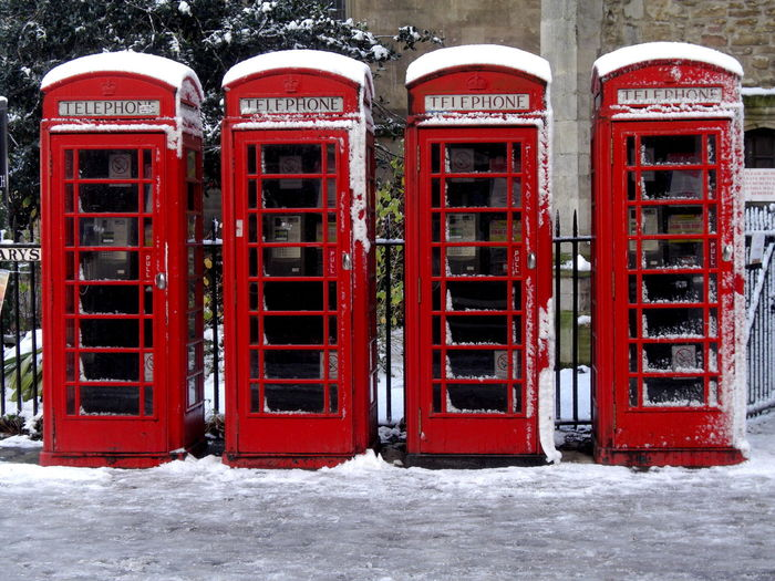 Red telephone booth in winter