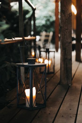 Table Burning Illuminated Candle Fire Focus On Foreground No People Architecture Heat - Temperature Lighting Equipment Oil Lamp Built Structure Building Indoors  Fire - Natural Phenomenon Electric Lamp Nature Wood - Material Chair Flame
