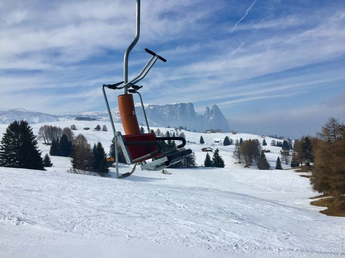 Seiser Alm mit Blick Richtung Völs am Schlern Sport Winter Empty Skiing Chairlift Seiser Alm Schlern Snow Winter Cold Temperature Sky Mountain Cloud - Sky Nature Scenics - Nature Beauty In Nature Environment White Color Landscape Mountain Range Snowcapped Mountain Ski Resort  Tranquil Scene The Great Outdoors - 2019 EyeEm Awards