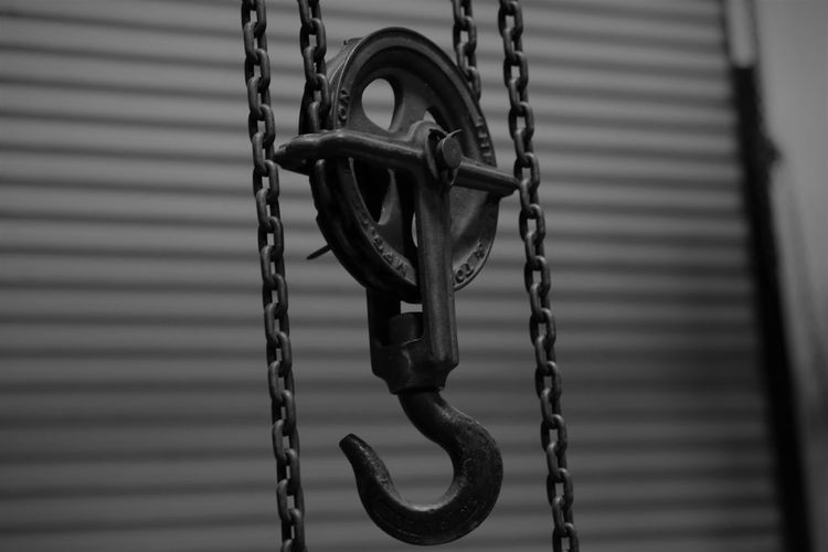 Close-up of chain hanging on rope
