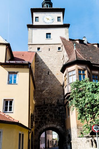 Low angle view of buildings against sky. Clock Face Clock City Cityscape Clock Tower Town History Old Town Window Balcony #urbanana: The Urban Playground