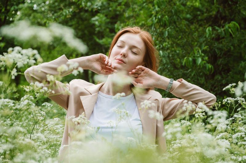 Beautiful young woman lying on land