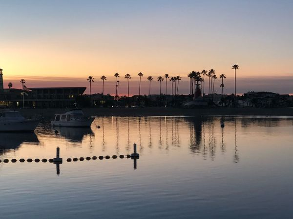 Serene sunrise Mirrored Reflection Mirrored Blue Water Blue Sky Orange Reflections In The Water Sunrise_sunsets_aroundworld Sunrise EyeEm Selects Water Sunset Reflection Waterfront No People Silhouette Outdoors Nature Beauty In Nature Clear Sky Built Structure Sky Harbor Scenics Nautical Vessel Architecture Day