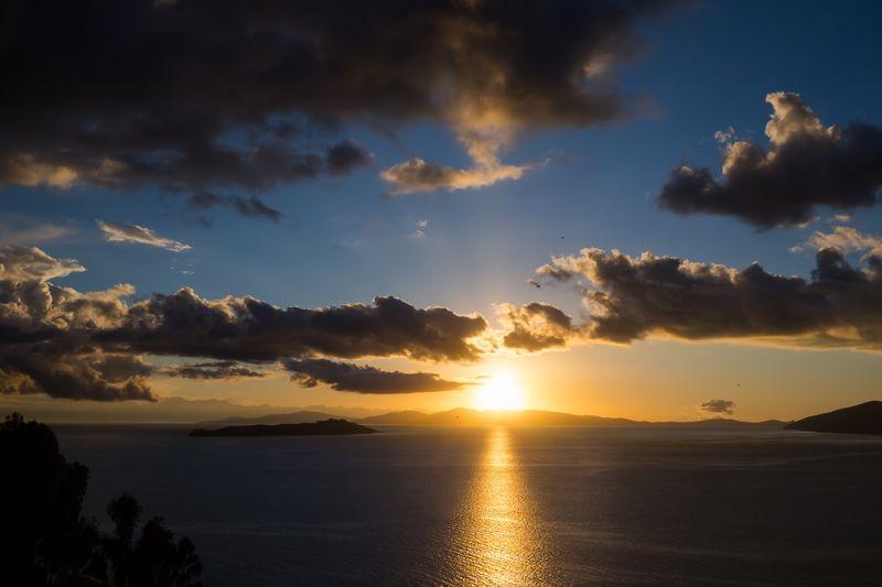Sunrise at Lake Titicaca, Bolivia 🇧🇴 Sunset Scenics Beauty In Nature Tranquility Tranquil Scene Sky Nature Sea Cloud - Sky Water Sun Sunlight Day Reflection Idyllic