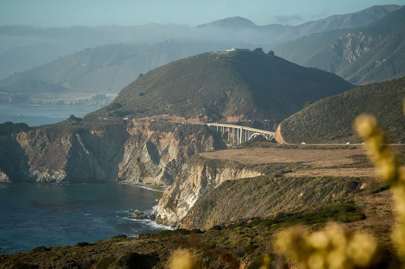Bixby Creek bridge at pacific coast highway at low sun Pacific Coast, Highway Travel Leisure Activity Lifestyles California Dreaming California Coast Landscape Bixby Bridge Mountain Water Scenics - Nature Beauty In Nature Mountain Range Nature Tranquil Scene Tranquility No People Built Structure Non-urban Scene Sea Transportation Land Bridge - Man Made Structure Outdoors