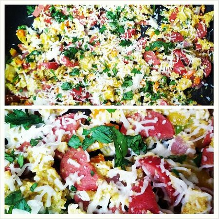 Breakfast! Mexicanstyle haha! Scrambled eggs with red onion, yellow & orange bell pepper, jalapeno, hot link sausage, cilantro, cheese...