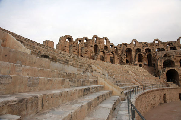 The amphitheater in El Jem, Tunisia Africa Amphitheater Ancient Arches Architectural Column Architecture Arena Building Exterior Built Structure El_jem Empire Erosion Famous Place Gladiator, Heritage History Landmark Old Old Ruin Roman Stone Stone Wall Tunisia Unesco