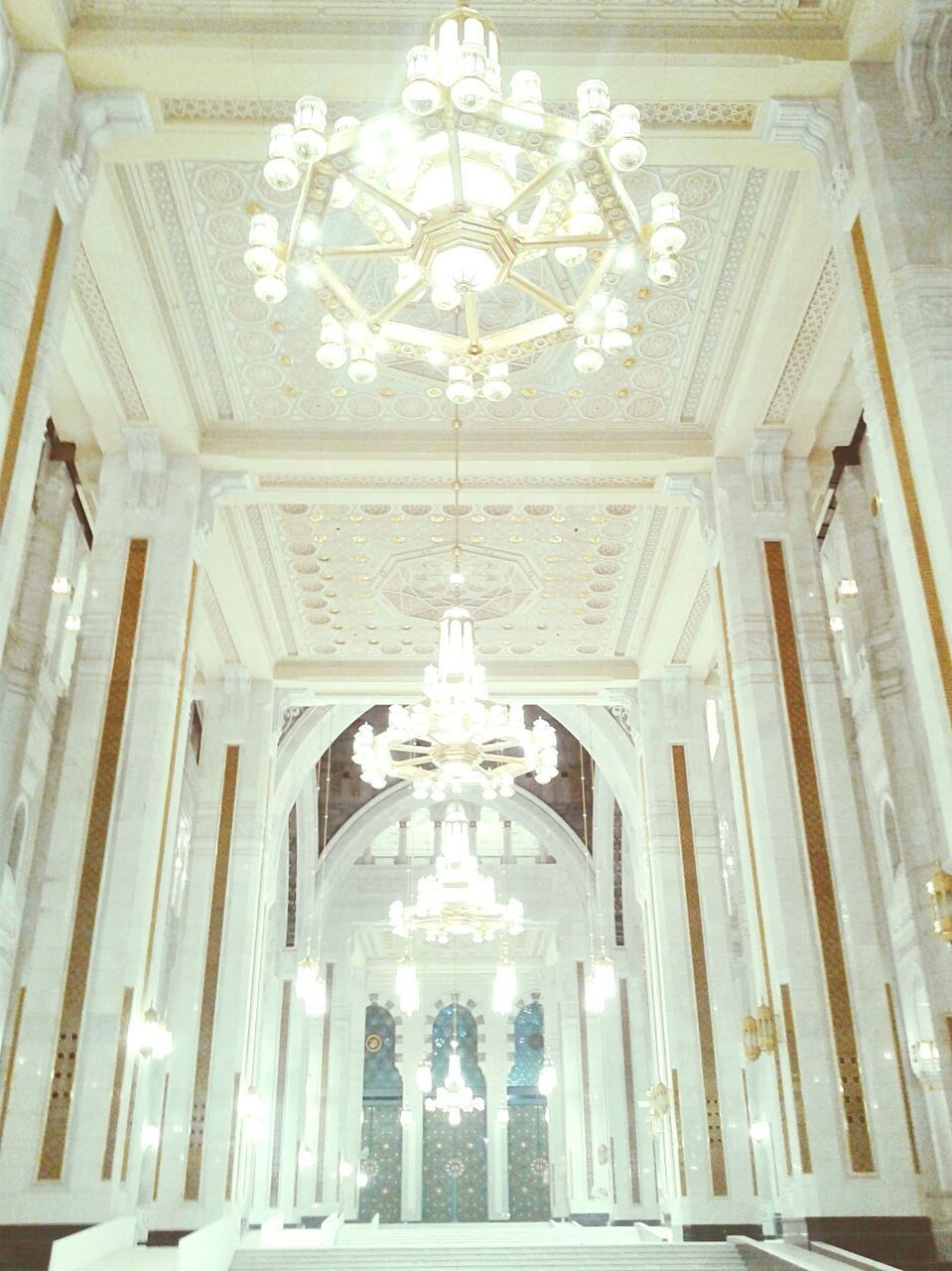 low angle view, ceiling, indoors, ornate, lighting equipment, architecture, illuminated, built structure, hanging, no people, architectural column, luxury, day