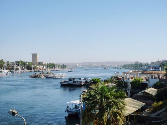 Boats on nile river against clear sky