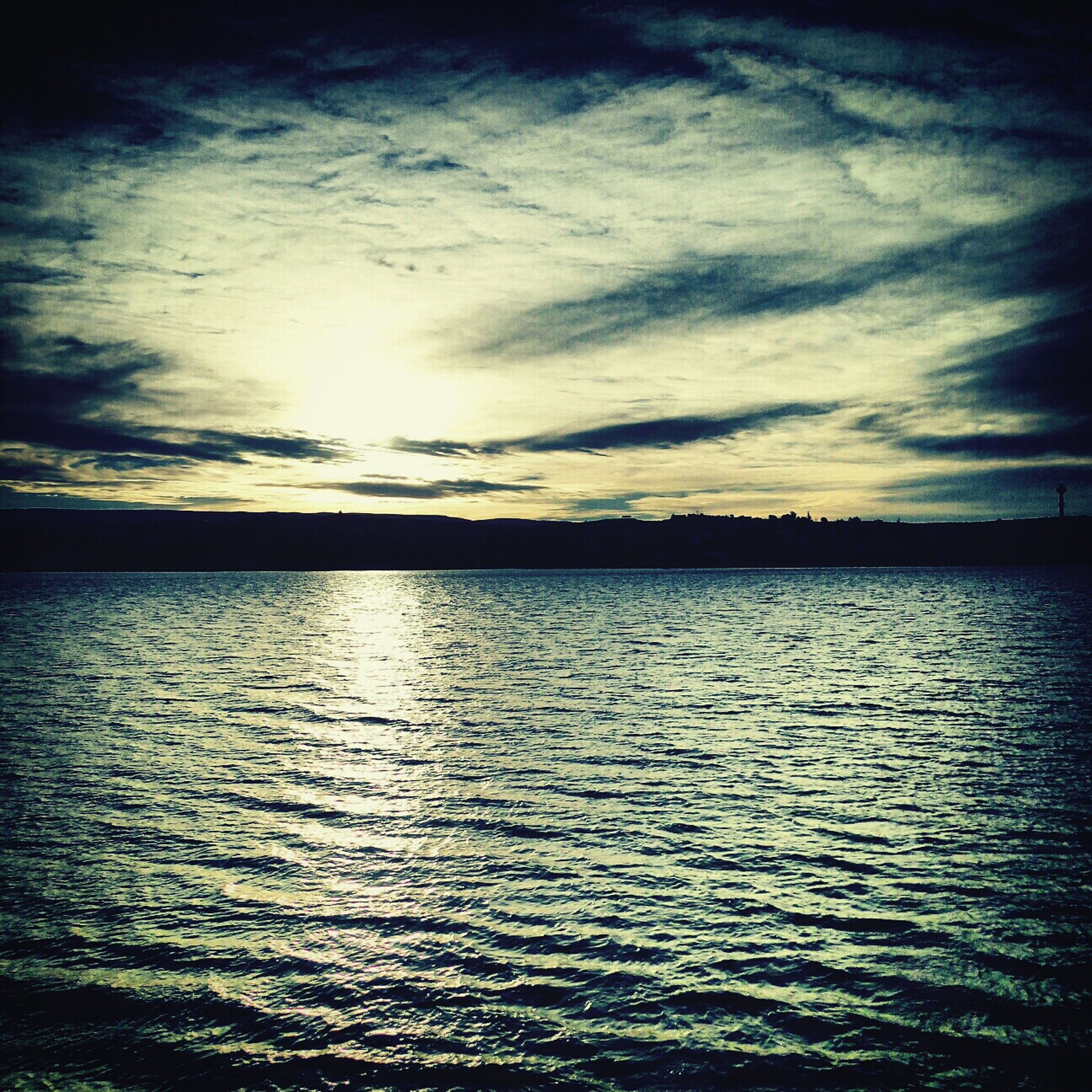 water, sky, tranquil scene, tranquility, waterfront, scenics, cloud - sky, beauty in nature, sunset, rippled, nature, reflection, cloud, sea, cloudy, idyllic, lake, silhouette, outdoors, calm