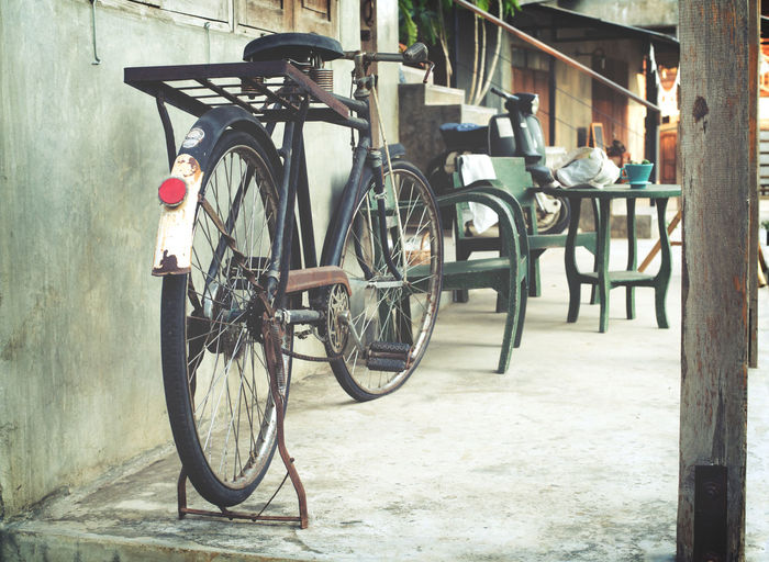 Vintage bicycle in coffee house, retro instagram effect Transportation Bicycle Mode Of Transportation Day Stationary No People Outdoors Architecture Wheel Built Structure Metal Nature Parking Vintage Antique Cafe Decoration