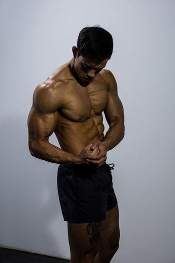 Close-Up Of Shirtless Muscular Man