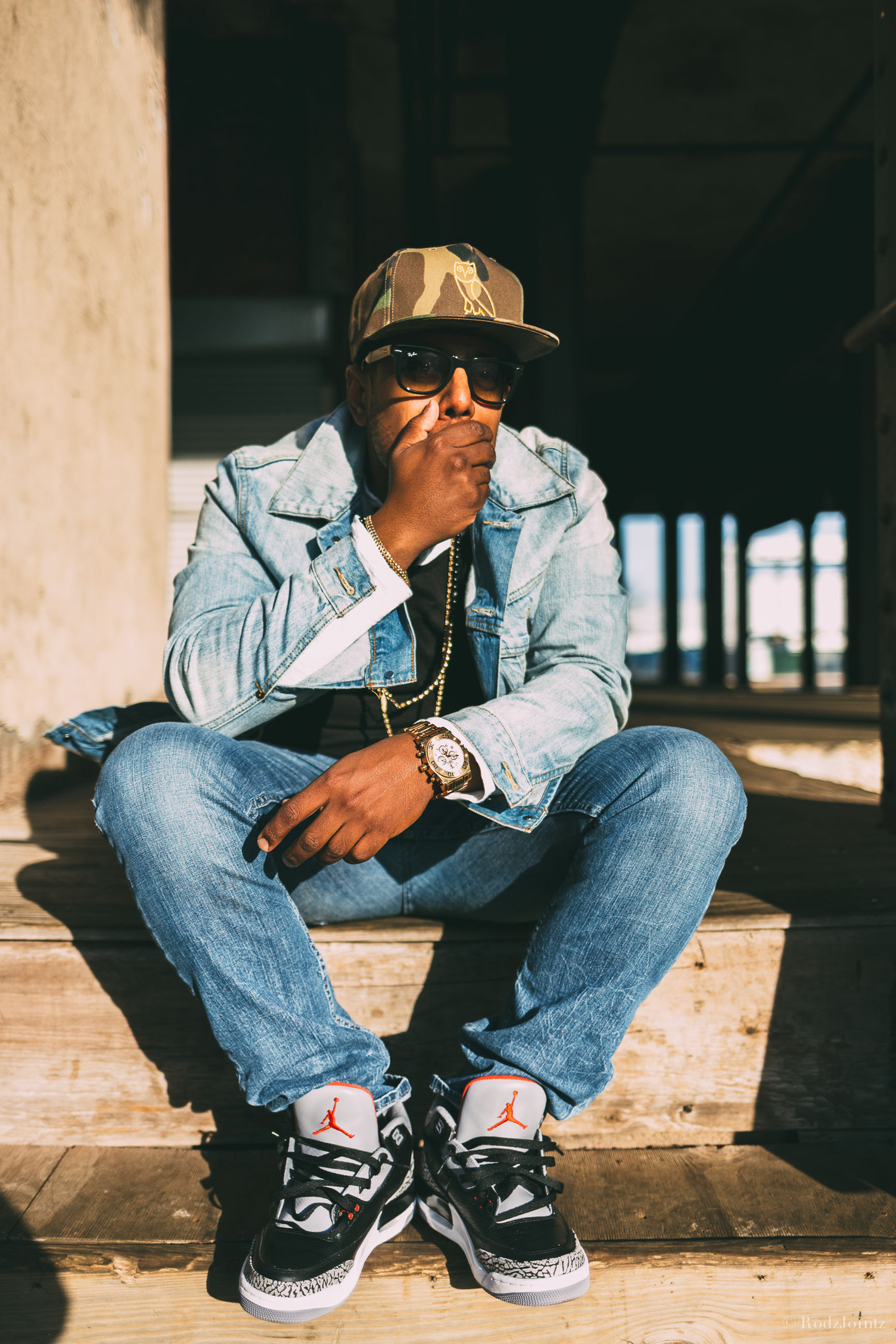 casual clothing, lifestyles, person, young men, leisure activity, young adult, full length, sitting, front view, mid adult men, portrait, mid adult, looking at camera, three quarter length, cap, sunglasses, standing, jacket