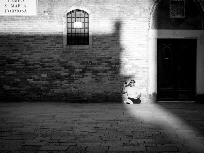 Its home time! Enjoying the last sunbeams of the day. Ancient Architecture Architecture Beer Time Black Black & White Black And White Blackandwhite Building Exterior Built Structure Day Drink Beer Enjoying Life Light And Shadow No People Old Buildings Quitting Time Relaxing Relaxing Moments Shadow Street Photography Streetphoto_bw Streetphotography Sunbeam Sunbeams Sunlight