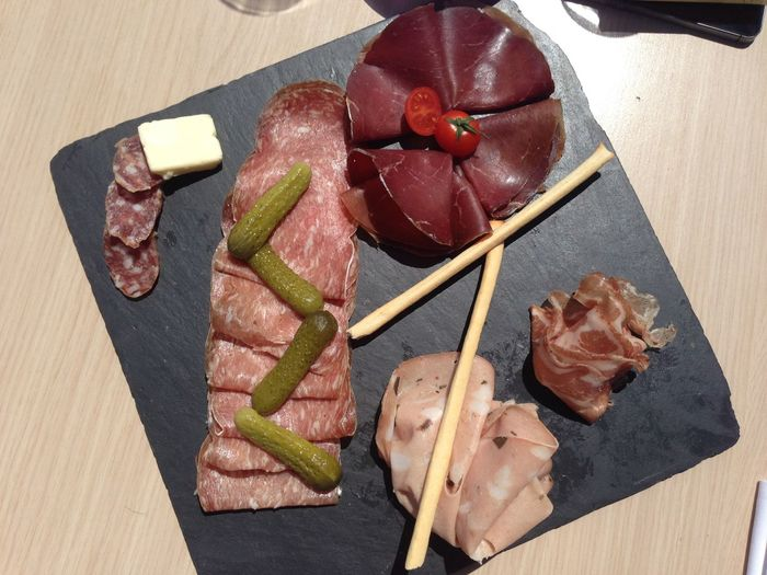 High Angle View Of Hams And Vegetables