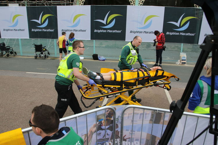 Finish Line  Marathon Running Stretcher With Wheels Ambulance Service Brighton Marathon Collapsed Exhausted Medics Paramedics Runner Sport Stretcher