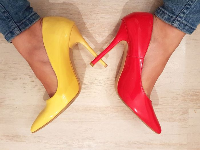 Human Body Part Red Stilletos Yellow Stilletos Stilletos High Heels Jeans Bluejeans Shoes Feet Woman Feet 100 Shades Of Yellow Fashion Fashion&love&beauty Paint The Town Yellow Red And Yellow Vibrant Colors Rethink Things