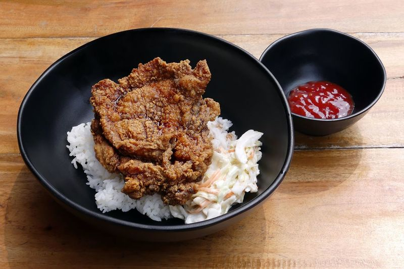 High Angle View Of Fried Chicken In Bowl On Table