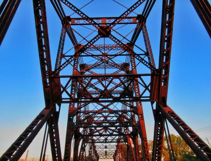 Is this art? Low Angle View Tourism Built Structure Blue Sky Architecture Metal Travel Bridge - Man Made Structure Engineering Outdoors Tall - High Bridges Bridge View Symmetry Connection Day Canonphotography Canon Sx520 Red EyeEm Bridge Railing Rust Rusty Skyview