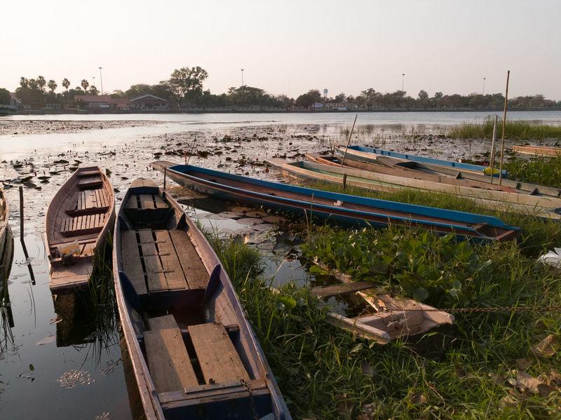 Fishing boats along the Nong Harn Sakon Nakhon. SakonNakhon ,Thailand Clear Sky Day Nature Nautical Vessel No People Outdoors Sky Tree Water