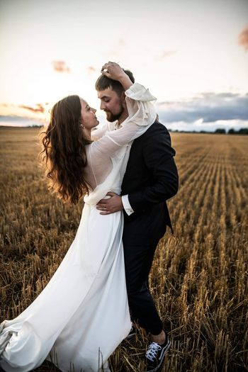 Young couple kissing on land