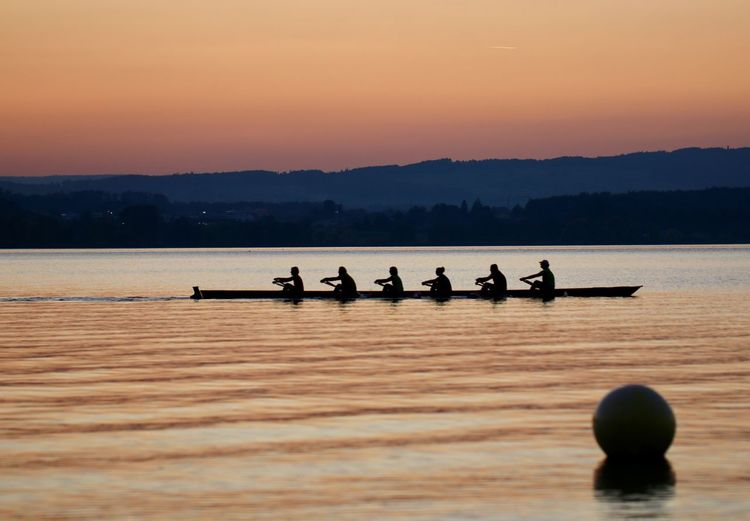 Water Nautical Vessel Transportation Sunset Group Of People Sky Rowing Beauty In Nature Silhouette Sport Nature Scenics - Nature Mode Of Transportation People Sculling Men Leisure Activity Real People Competition Rowboat