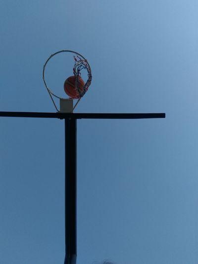 Directly Below Shot Of Basketball In Hoop