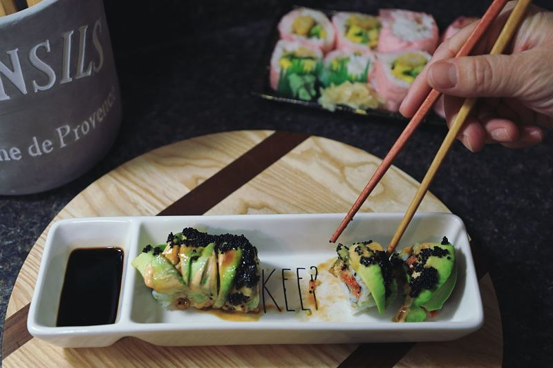 Keep Food And Drink Food Human Hand Freshness Human Body Part Table Plate Indoors  Ready-to-eat Chopsticks Japanese Food Real People One Person Serving Size Close-up Holding Seafood Healthy Eating Sushi Men