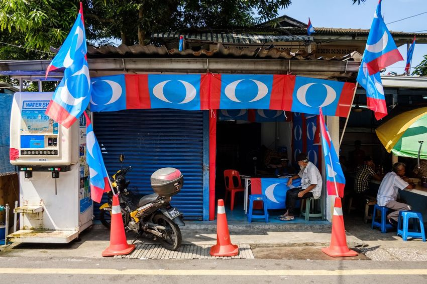 Political flags outside of a diner during election season. Kuala Lumpur Malaysia Streetphotography People EyeEmNewHere Street EyeEm Selects Politics And Government City Flag