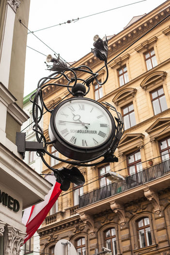 A clock in Vienna The Architect - 2018 EyeEm Awards Vienna Architecture Building Exterior Built Structure Clock Clock Face Close-up Day Hanging Low Angle View No People Outdoors Roman Numeral Sky Time The Traveler - 2018 EyeEm Awards