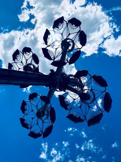 La Ronde Sky Cloud - Sky Low Angle View Nature No People Plant Outdoors Day Tree Blue Silhouette Beauty In Nature Branch Growth Lighting Equipment Built Structure Decoration Architecture Fragility Vulnerability