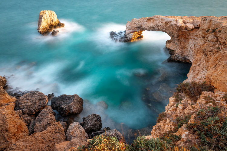 Rock Water Sea Rock - Object Solid Beauty In Nature Nature Scenics - Nature Land Rock Formation No People Motion Tranquility Geology Day Outdoors Tranquil Scene Physical Geography Blue Turquoise Colored Power In Nature Rocky Coastline