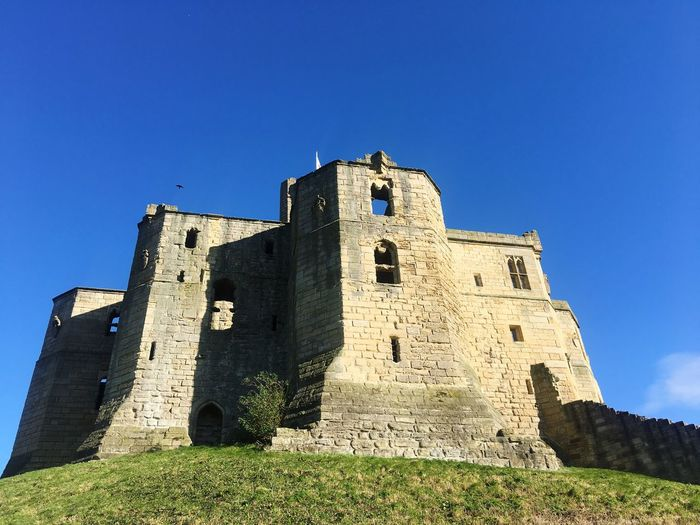 History Architecture Building Exterior Built Structure Low Angle View The Past Castle Medieval Day Travel Destinations Ancient Blue Travel Fort Outdoors Clear Sky No People Sky Grass Ancient Civilization