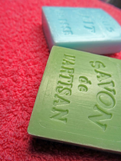 Soap craft products Soaps Blocks Craft Product Bars Of Soap Soaps Of Craft Worker Green And Blue On Pink Towel Hygiene Theme Vertical Photography Selective Focus High Angle View Variation Close-up