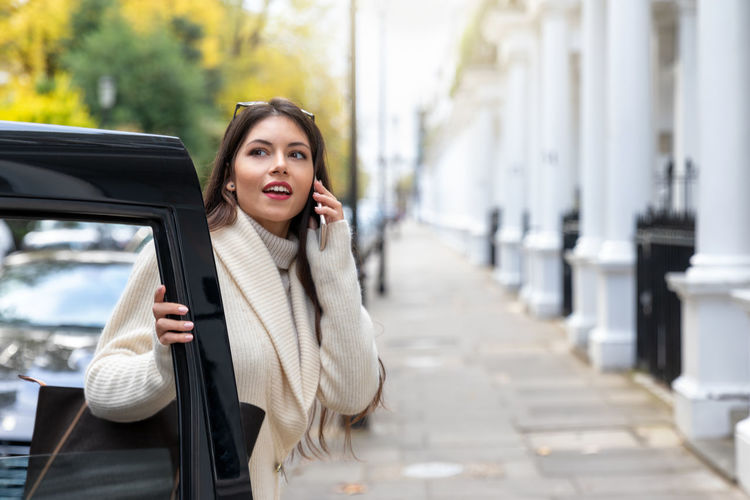 Portrait of a young, attractive businesswoman in London getting of the taxi on a typical London street One Person Communication City Young Women Mobile Phone Telephone Beautiful Woman Outdoors Car Smiling Using Phone Transportation Cab Taxi London Street Businesswoman Black Cab Victorian Portrait Talking Using Adult Woman Business International Women's Day 2019