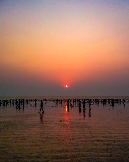 Sunset at Juhu beach, Mumbai Sunset Sky Reflection Outdoors Travel Destinations Tranquility Beauty In Nature Beach Togetherness Water Nature Scenics People Day Sea Rural Scene