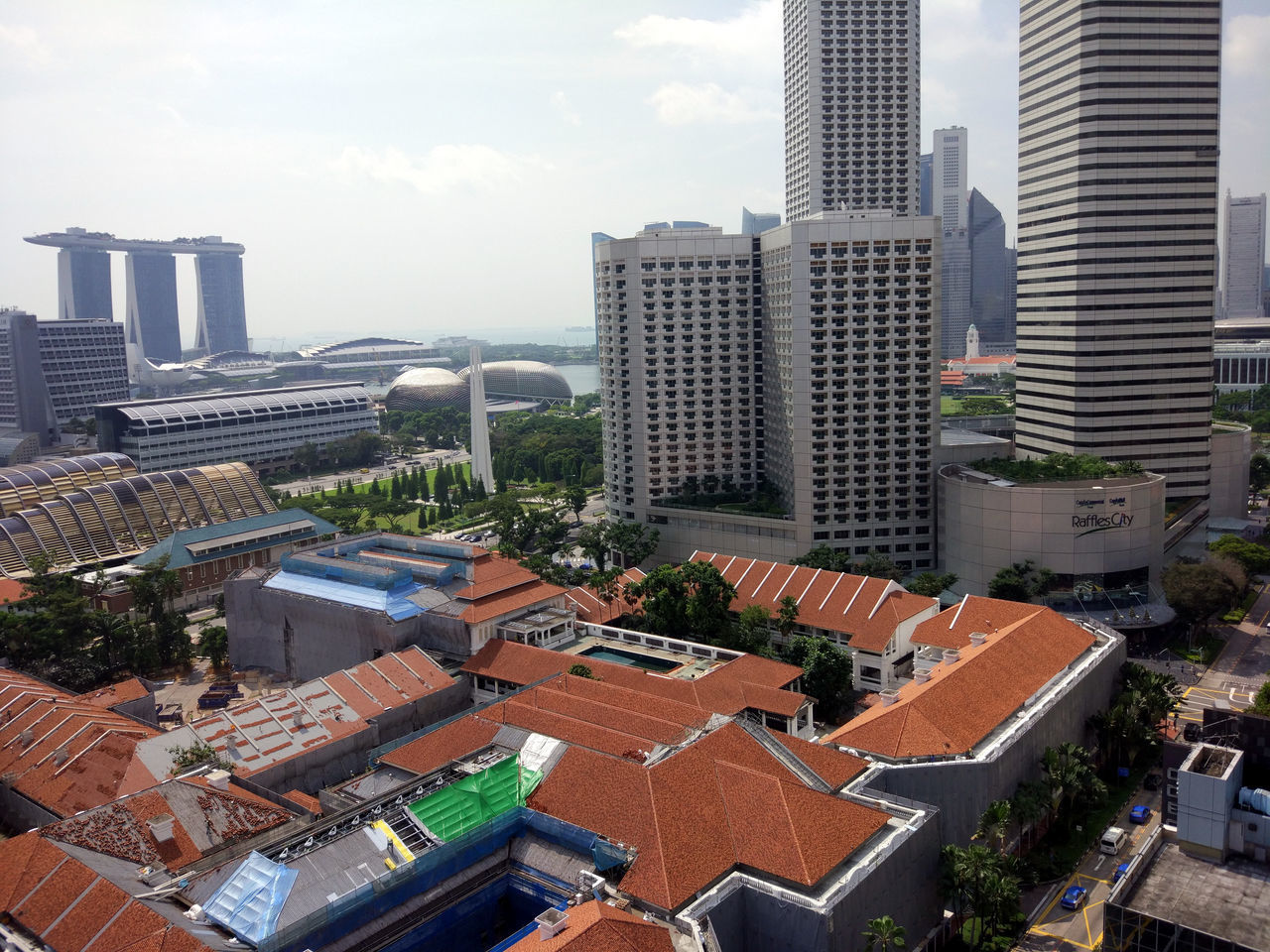 architecture, building exterior, skyscraper, cityscape, city, built structure, high angle view, crowded, development, roof, outdoors, day, modern, aerial view, sky, residential