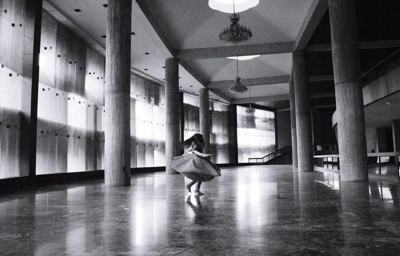 Little girl in empty hallway