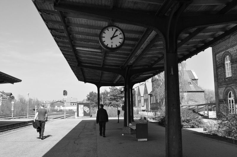 Lights and shadows at 14:05 Architecture B&w B&w Street Photography Built Structure City Clock Clock Face Day Hour Hand Men Minute Hand Outdoors People Real People Sky Time Walking