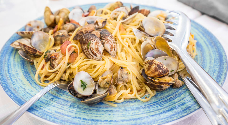 Close-up of clams with spaghetti served in plate