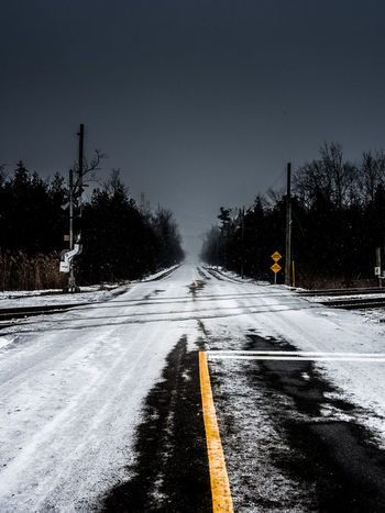Cold Temperature Day Highway Nature No People Outdoors Road Sky Snow Snowing The Way Forward Transportation Tree Winter