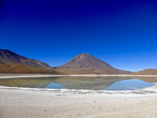 Altiplano Beauty In Nature Blue Bolivia Clear Sky Desert Dust Geology Lagoon Lake Landscape Majestic Mountain Mountain Range Outdoors Physical Geography Reflections Sand Scenics Uyuni Laguna Verde Salar De Uyuni Colour Of Life