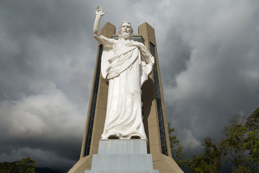 Portrait view of the El Santisimo Jesus Statue near Bucaramanga, Colombia. Catholic Colombia Eco Park Floridablanca Jesus Latin America Santander Statue Bucaramanga Christ Ecoparque El Santisimo Jungle Landmark Landscape Low Angle View No People Park Santisimo Sculpture Sky South America Statue Theme White