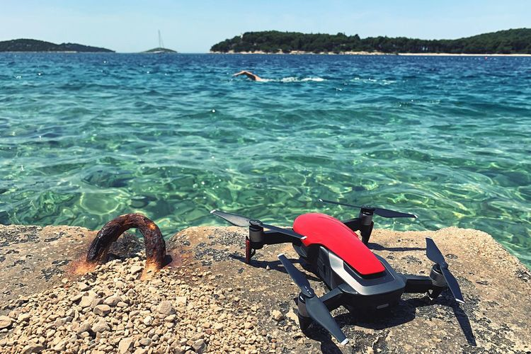 A drone Water Nature Sunlight Sea Beauty In Nature Day Scenics - Nature Sky Land Beach Tranquility Real People Sport Tranquil Scene Leisure Activity Outdoors Aquatic Sport