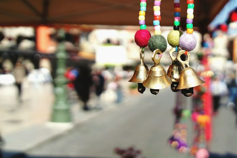 Close-Up Of Hanging Bells Against Blurred Background