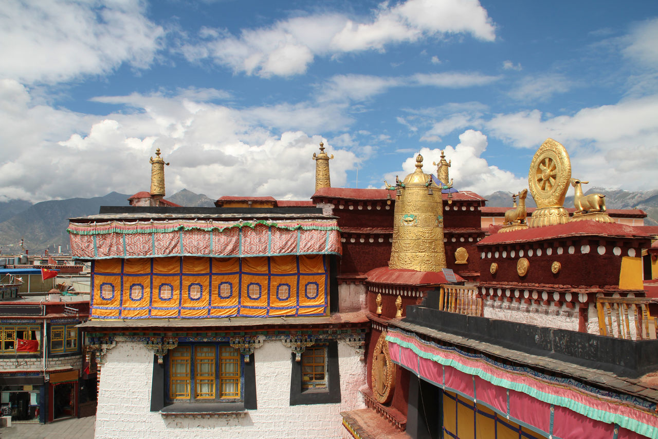 architecture, building exterior, built structure, cloud - sky, religion, spirituality, place of worship, sky, day, roof, travel destinations, low angle view, cultures, outdoors, no people, history